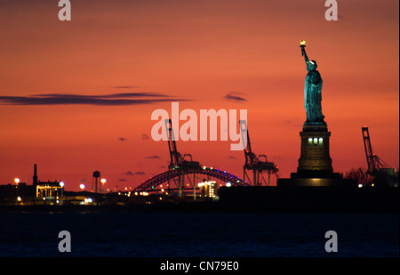 Statue of Liberty seen at dusk from Battery Park in New York, NY, USA, January 2, 2010. (Adrien Veczan) - Stock Photo