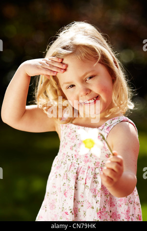 Girl holding daffodil flower - Stock Photo