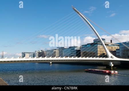 Barge under Samual Beckett Bridge - Stock Photo