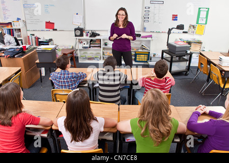 Female Teacher ethnically diverse students attention.multi ethnic multi racial diversity racially diverse multicultural - Stock Photo