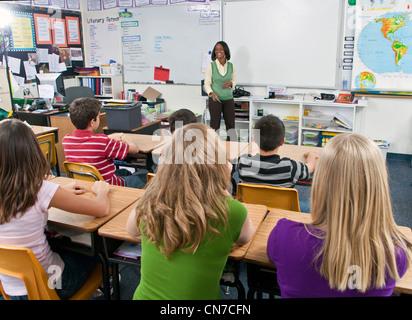 Boys girls school interracial female Teacher group multi ethnic multi idiversity racially diverse multicultural - Stock Photo