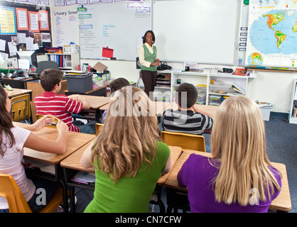 11-13 year old olds multi cultural multicultural Ethnically diverse multi ethnic racial Students desks listen  African - Stock Photo
