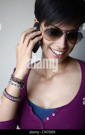 Young attractive woman talking on her mobile phone - Stock Photo