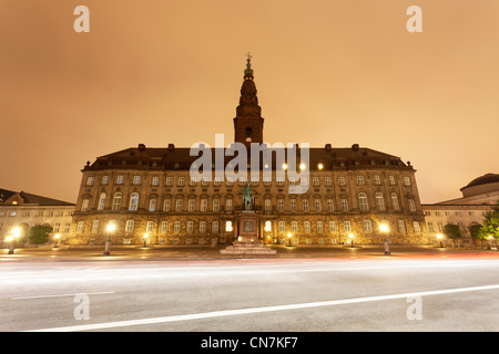 Ornate building lit up at night - Stock Photo