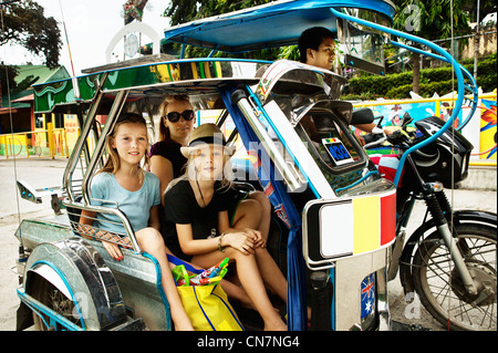Family riding in alternative transport - Stock Photo