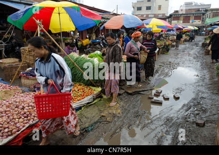 Muddy alleyway in the daily vegetable market. Augban. Southern Shan State. Myanmar. - Stock Photo