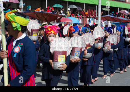 Pa Oh minority women marching during the procession on Pa Oh National Day. Taungyi. Shan State. Myanmar. - Stock Photo