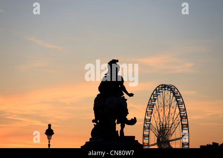 France, Paris, the Equestrian statue of Louis XIV in Cour napoleon of the Louvre museum and the Great Wheel in the - Stock Photo