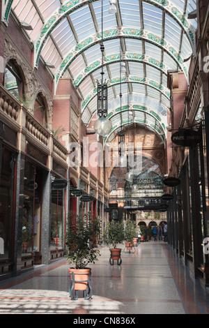 Harvey Nichols department store and designer shops in Cross Arcade Victoria Quarter shopping centre Leeds Yorkshire - Stock Photo