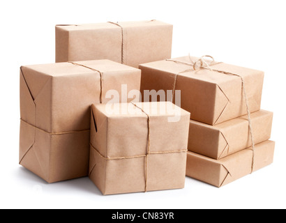 Group of parcel wrapped with brown packing paper isolated on white - Stock Photo