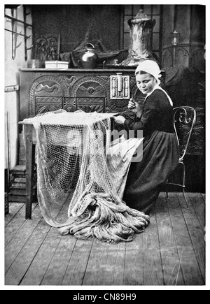 First published 1915 Fishing Net maker in Brittany woman - Stock Photo