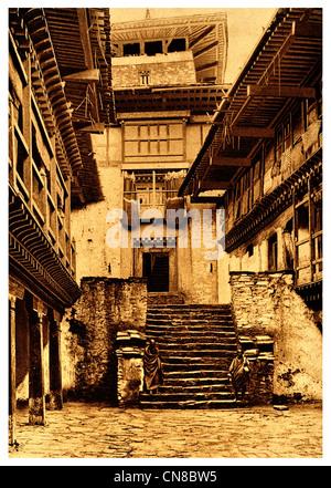 First published 1914 Bhutan courtyard temple courtyard dzong fortress - Stock Photo