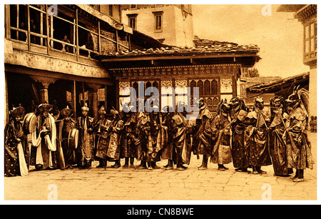 First published 1914 Masked Dancers Tongsa trongsa Jong Bhutan lamas monks dance devil Buddhism - Stock Photo