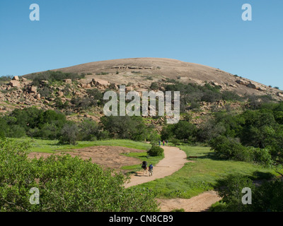 HIkers on Summit Trail at Enchanted Rock - Stock Photo