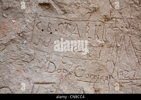 Register Cliff, where pioneers traveling west on the Oregon Trail carved their names into the sandstone cliff. - Stock Photo