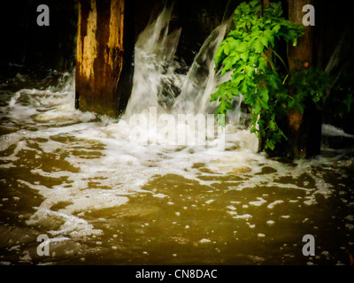 Water flowing through an old abandoned lock at Walton - Stock Photo