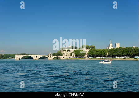 France, Vaucluse, Avignon, Pont d'Avignon with the Palace of the Popes in the background listed as World Heritage - Stock Photo