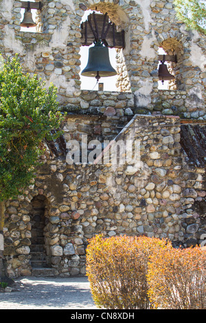 A bell tower in the cemetery at Mission San Miguel in Central California's wine country near Paso Robles - Stock Photo