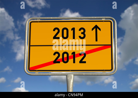 German road sign traffic 2012 and 2013 with blue sky and white clouds - Stock Photo
