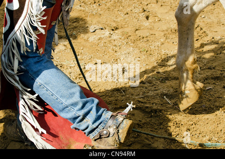 Cowboy wearing muddy boots in a rodeo show. - Stock Photo