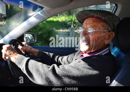 A very old man with a valid driving license drives a car - Stock Photo