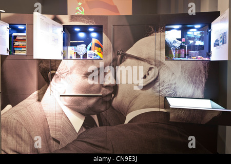Germany, Berlin, DDR Museum, a museum opened in 2006 to recall the everyday life of former East Germany, kiss between - Stock Photo