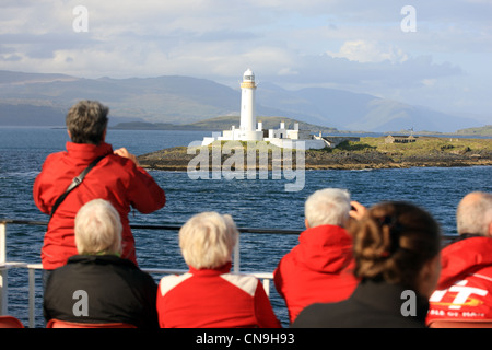 Tourists photographing and looking at Lismore Lighthouse on the 'Isle of Mull' Calmac Ferry from Oban to Craignure - Stock Photo