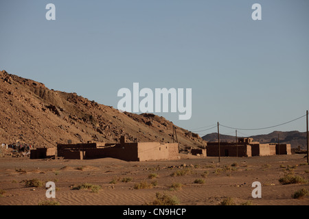 Typical mud-brick built buildings, Draa Valley, southern Morocco, Africa - Stock Photo