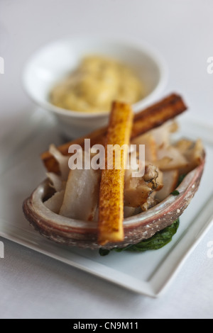 France, Bouches du Rhone, Cassis, Ormeau cooked wild a la plancha, spinach fondue, matches and soft polenta with - Stock Photo
