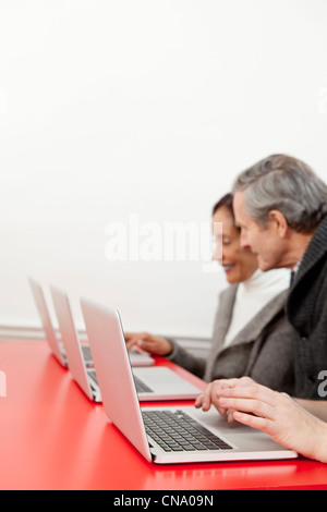 Business people working on laptops - Stock Photo