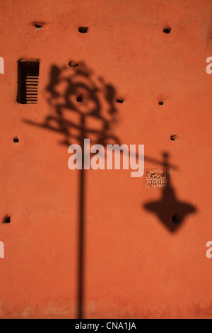 City walls & shadow of street light in the afternoon, Marrakech,Morocco,north Africa - detail - Stock Photo