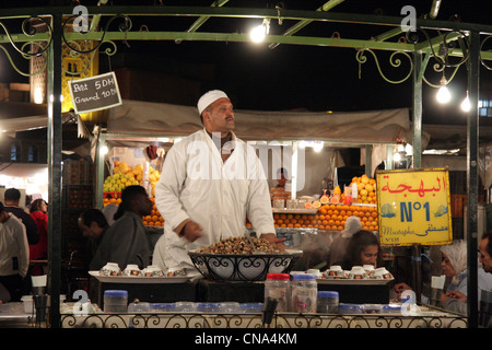 A stall holder in the heart of Place Djemaa el Fna at night, Marrakech,Morocco, north Africa - Stock Photo