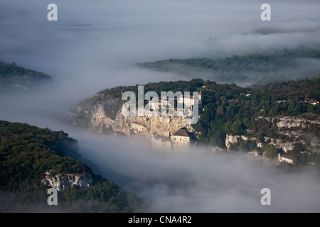France, Lot, Rocamadour, Aerial view of the city and its religious shrines dominated by its castle in the Canyon - Stock Photo