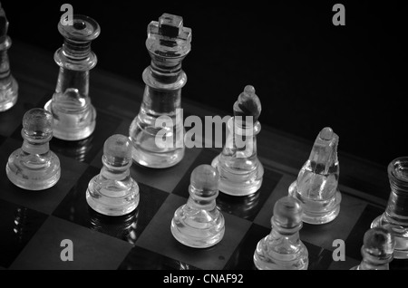 Glass chess set in black and white. - Stock Photo