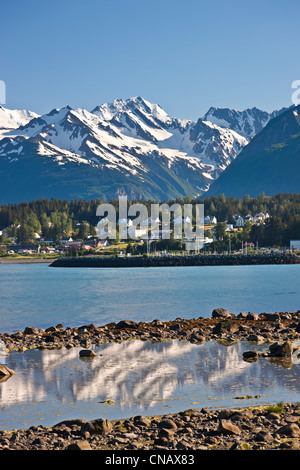 View from Portage Cove of Haines and Ft. Seward with a cruise ship docked in the harbor, Southeast Alaska, Summer - Stock Photo