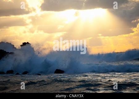 Waves crashing on rocky beach - Stock Photo