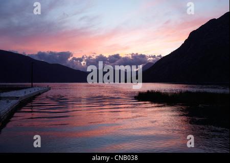 Sunset sky reflected in still lake - Stock Photo