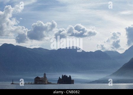 Castle on island in still lake - Stock Photo