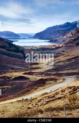 Stunning viewpoint from the A832 in Glen Docherty,Scotland showing the winding road down to Kinlochewe and the tip - Stock Photo