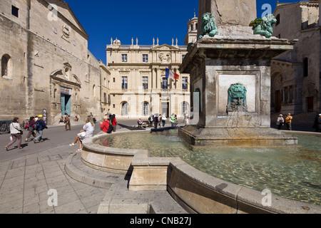 France, Bouches du Rhone, Arles, Place de la Republique, fountain and city hall - Stock Photo