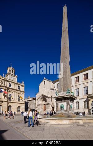 France, Bouches du Rhone, Arles, Place de la Republique, fountain, entrance to the Church of Saint Trophime classee - Stock Photo