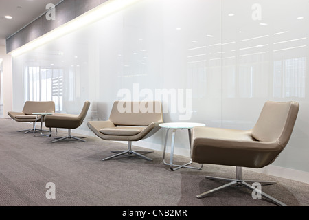 white glass wall beige chairs corridor city office - Stock Photo