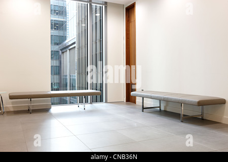 bank reception benches window city waiting room - Stock Photo