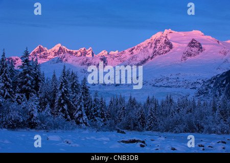 Panoramic view of alpenglow on the Coast Mountains above Mendenhall Glacier, Tongass National Forest, Southeast - Stock Photo