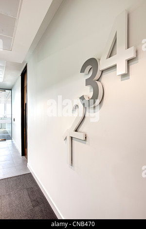 1 2 3 4 numbers wall floor level reception area - Stock Photo