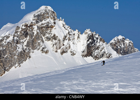 Alpine skiers on the Juneau Ice Field with Rhino Peak in the background, Juneau, Southeast Alaska, Winter - Stock Photo