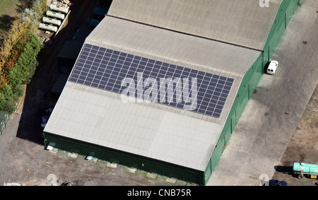 aerial view of solar panels on a farm building - Stock Photo