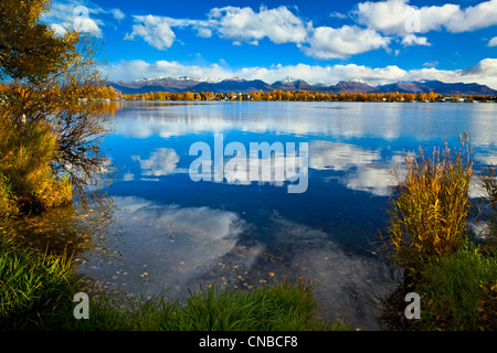 Scenic view of golden aspens at Lake Spenard, Anchorage, Southcentral Alaska, Autumn - Stock Photo