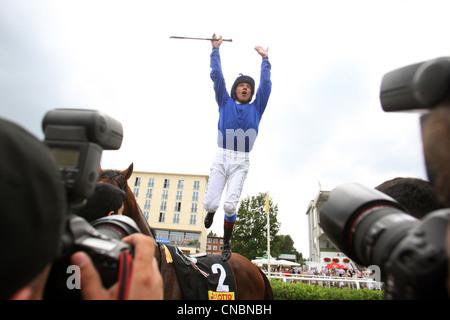 Jockey Lanfranco Dettori jumping in the air, Hamburg, Germany - Stock Photo
