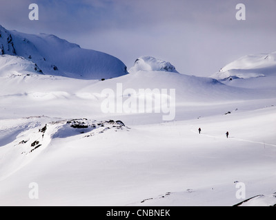 2 people ski touring in the Hardanger region of Norway - Stock Photo